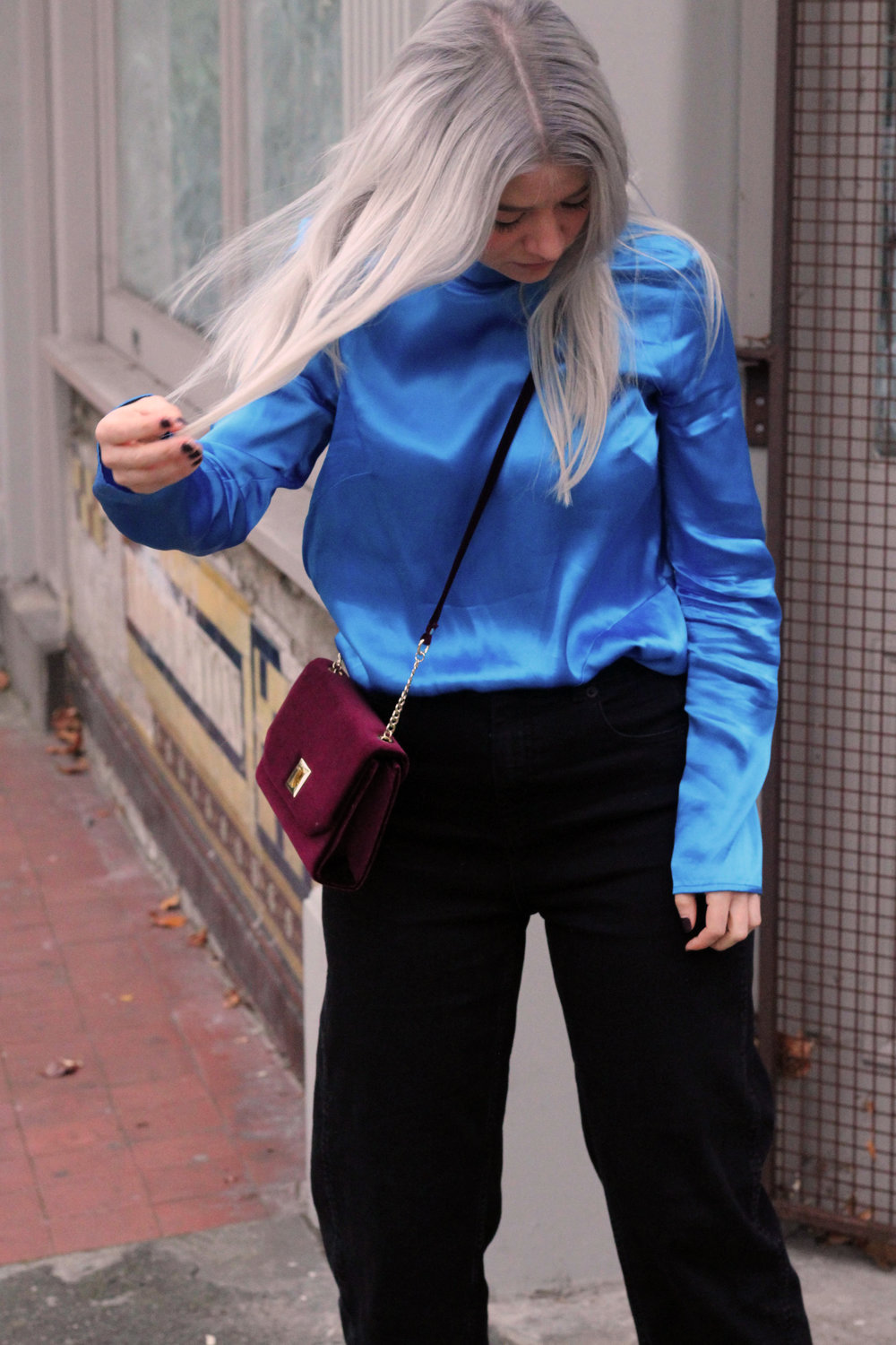 blue satin top, black whitles jeans, velvet heels, velvet handbag, grey hair 1