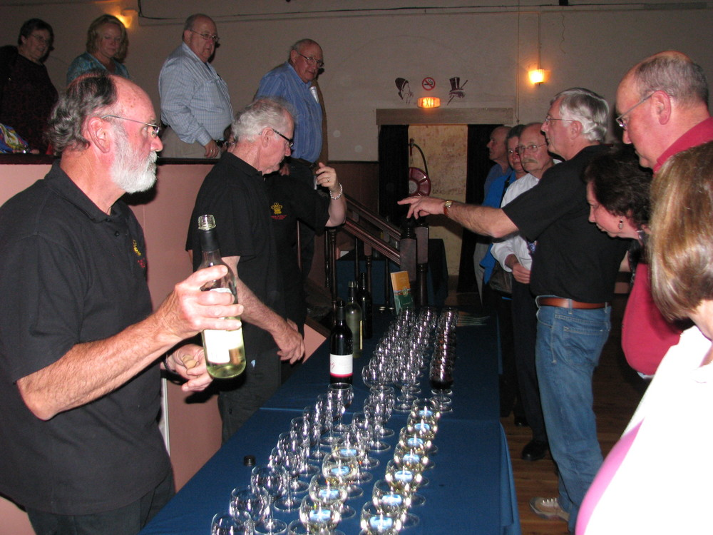Patrons enjoy the magnificent wine from sponsor Steins Wines.JPG