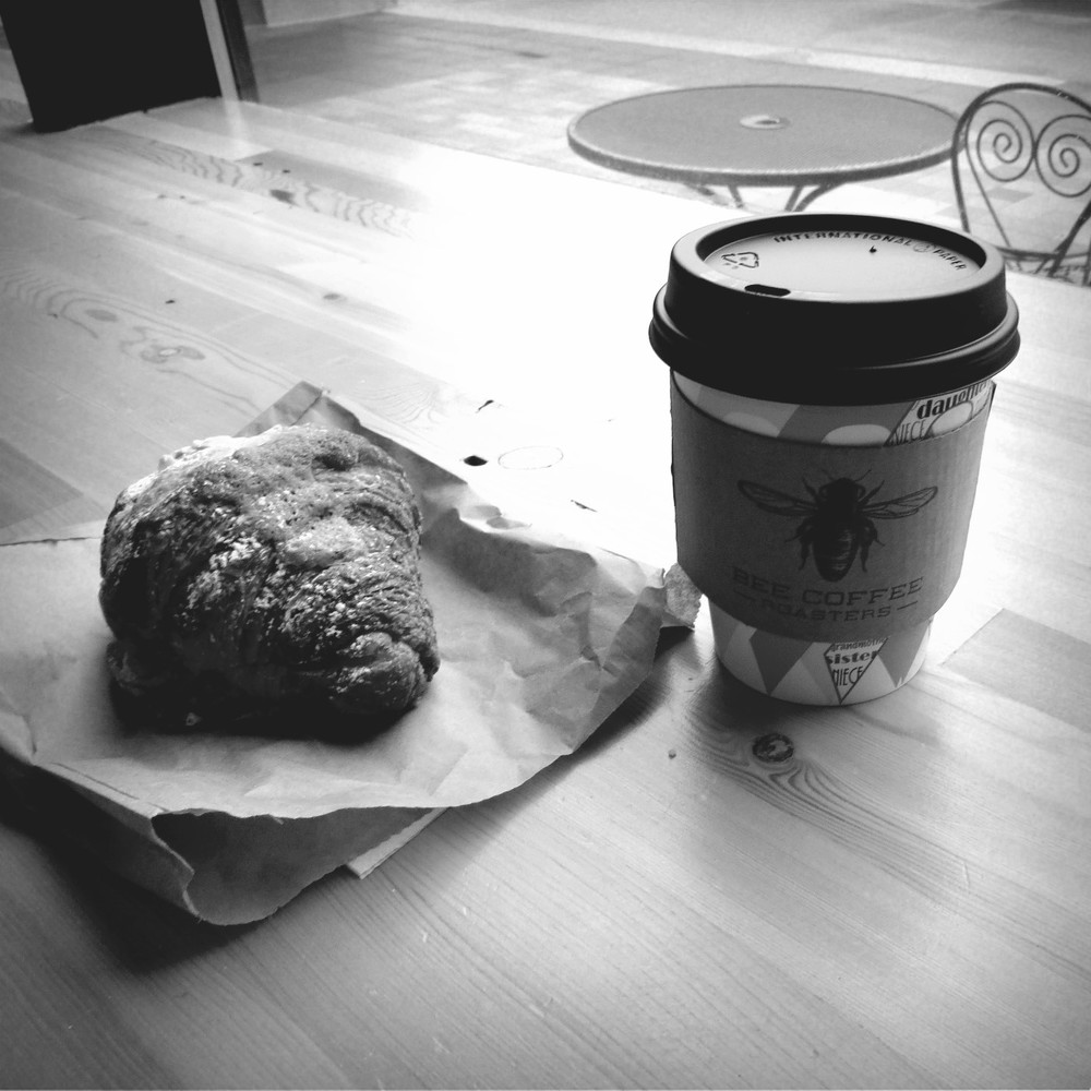 Chai latte and almond croissant at Bee Coffee.