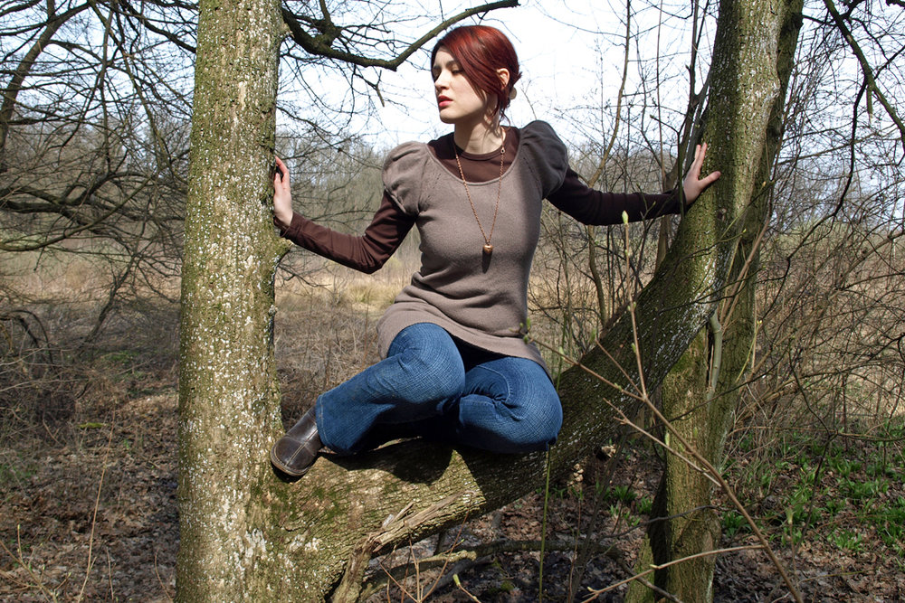 I'm too lazy right now to look for old pictures I took way back when I went on long walks while being depressed so here's a random photo of me sitting on a tree from 2009.