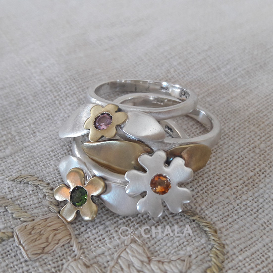 3 rings with flowers and leaves.small.jpg