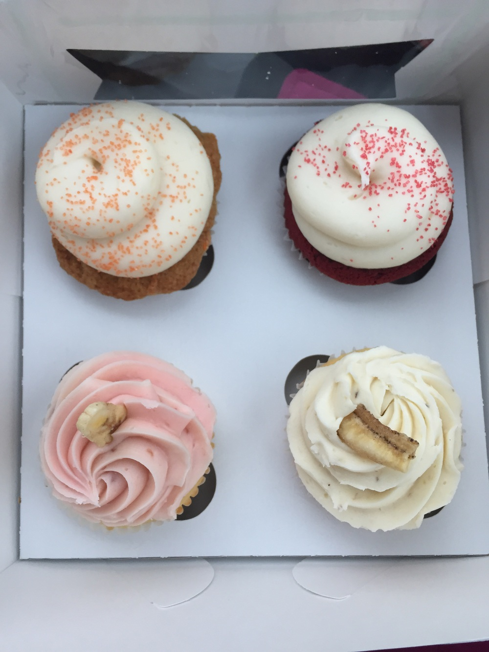 TOP LEFT: Carrot Cake; TOP RIGHT: Red Velvet; BOTTOM LEFT: Strawberry Banana; BOTTOM RIGHT: Strawberry Jam filled Banana Cupcate