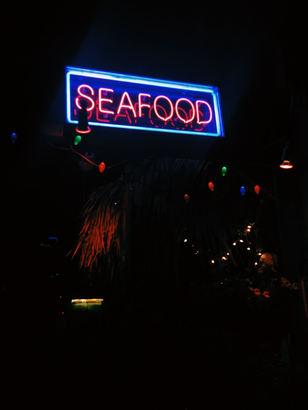 Surf Bar's neon 'Seafood' sign out front
