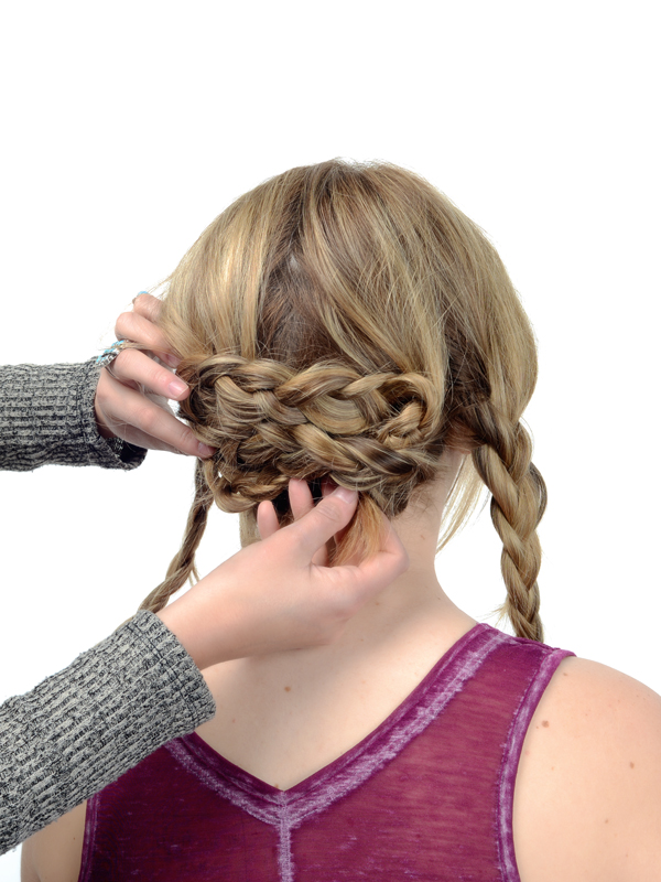 Next, wrap the lower braid on the right hand side towards the left. Keep the braid nice and tight against the first braid.