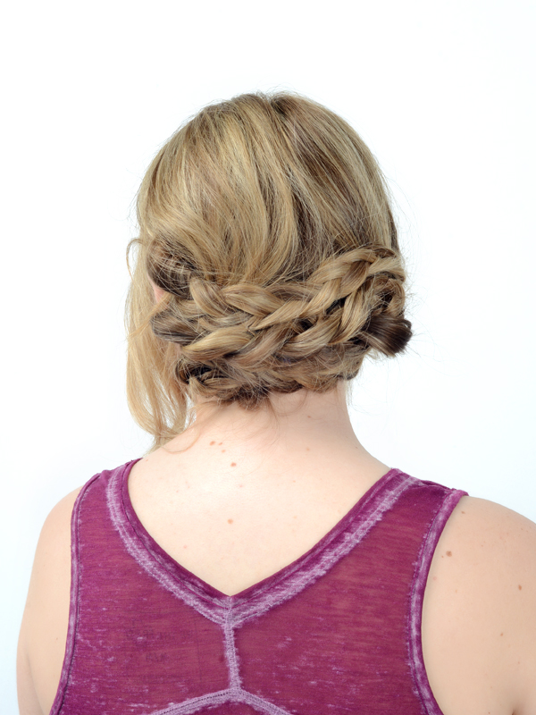 Repeat the process with the two upper braids, overlapping each section slightly for lots of volume. Make sure everything is secure and tuck in any loose ends. Work your fingers through the entire knot, loosening slightly for a more relaxed, boho look.