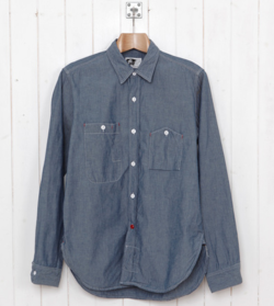 Most chambray shirts are liker dinner at your favorite Mexican joint– they're comfortable, they're familiar, they're reliable. You don't have to put in a lot of thought, because (if experience tells you anything) you're guaranteed to feel pretty good. This shirt is not that. This shirt is like… like drinks at the secret, invite-only bar that your friend who lives in Los Angeles told you about. At its core, it's classic and timeless. But it's a cut above. Fresh. Innovative. Full of… liquor (just kidding). Forget the metaphor– this chambray work shirt by  Engineered Garments  is something special. With red accents (including the button, reminding you to tuck it in and dress it up) and quirky, asymmetrical pockets, it's definitely not your average work shirt. Which is good, because man cannot live on Mexican food alone. Er. Get it  here .