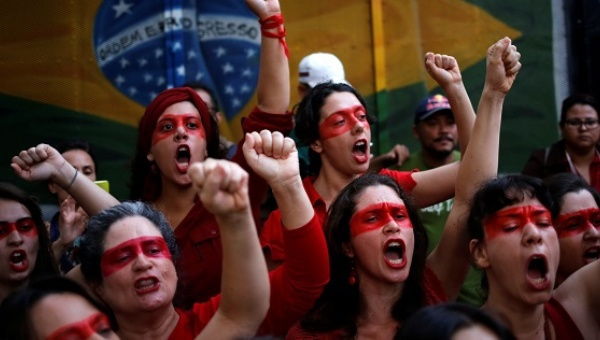 Brazil's MST landless workers' movement protest against interim President Michel Temer and in support of Dilma Rousseff in Sao Paulo, May 22, 2016. Image credit: Tele Sur TV.