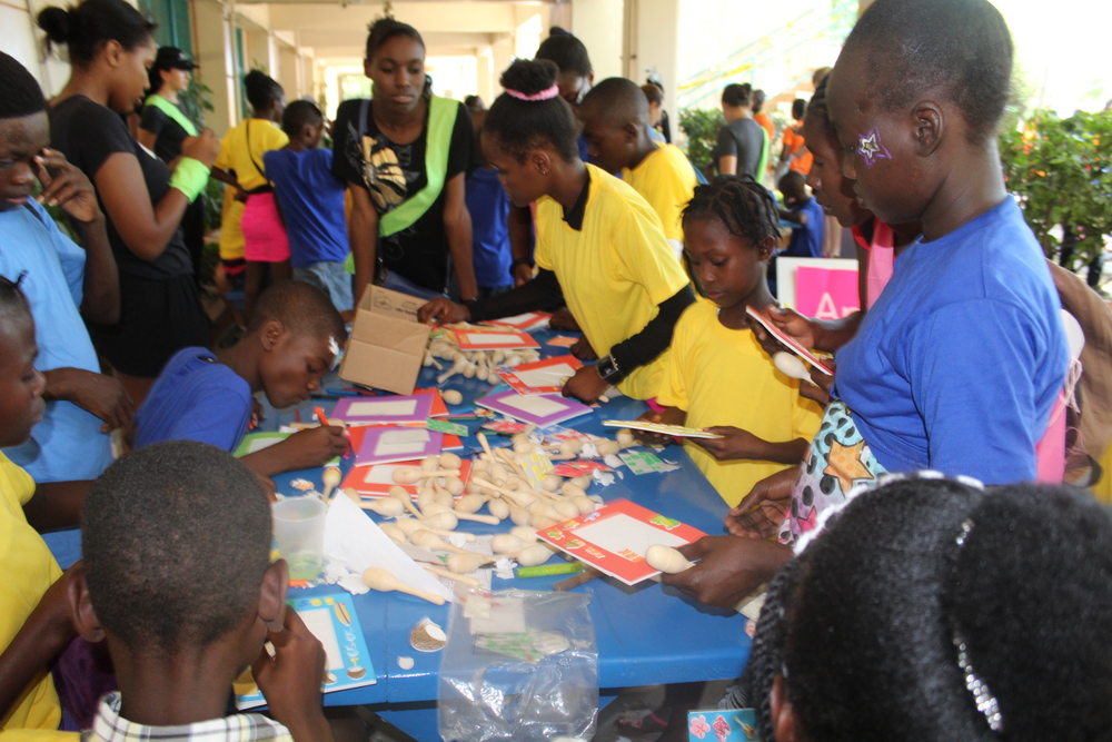 Children decorate maracas at the arts and crafts table organized by the US Navy.     (Photo credit: Maha Jiha)