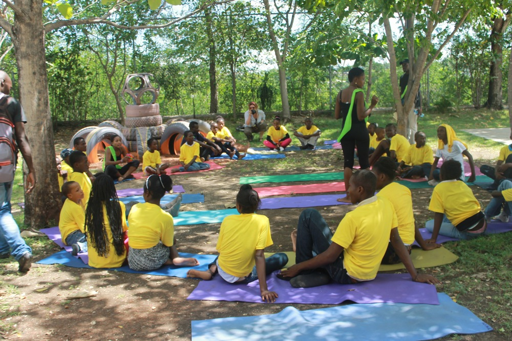 Ayiti Yoga leads a yoga class.     (Photo credit: Max Edward Hollant)