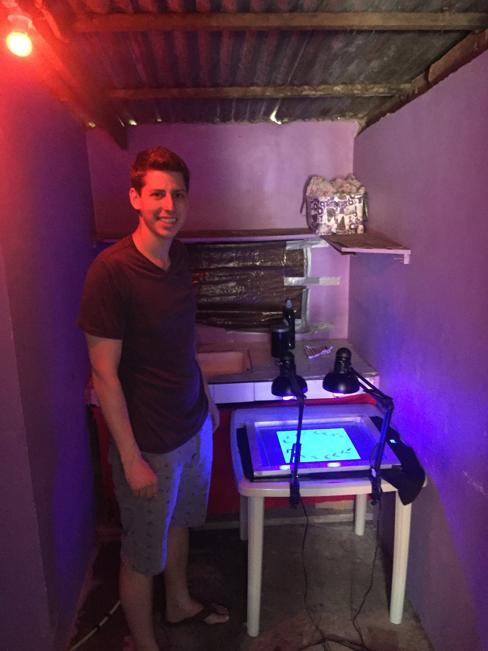 Andrew in the makeshift darkroom he researched and set up for ABR