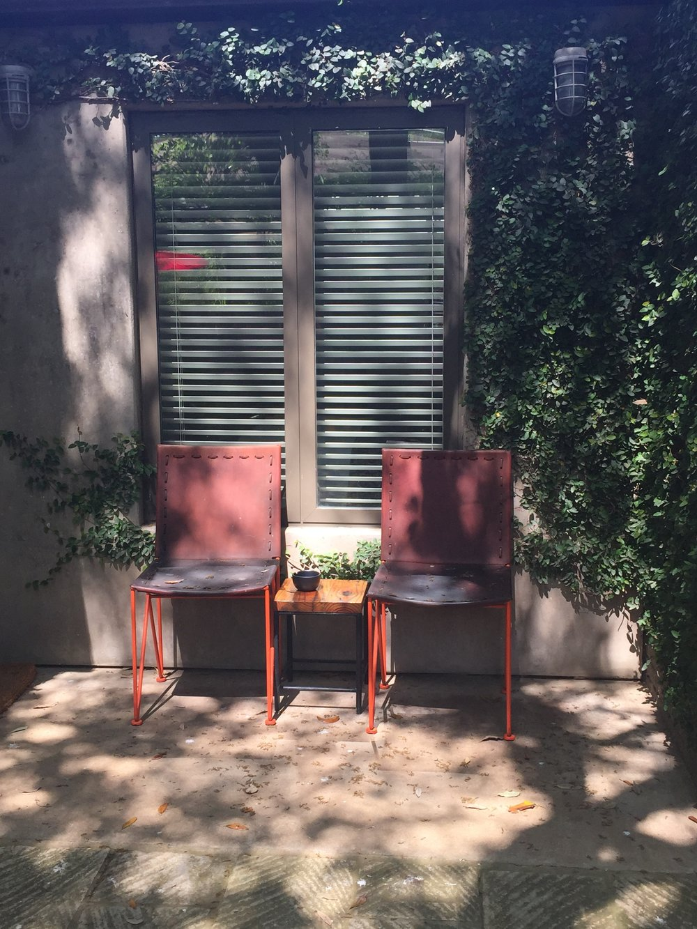 A lovely patio inviting you to explore your room at the Hotel San Jose.  Design: Bunkhouse