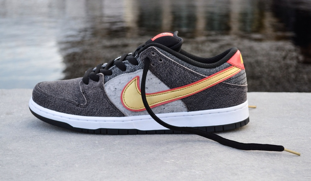 "The Nike SB ""Beijing"" dunk low pictured above, features a texture upper that uses mismatch panels of a light grey suede to make each pair truly unique and a 1 of 1."