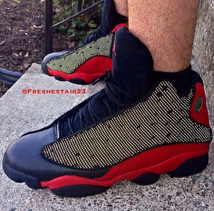 "An on foot look at the 2004 version of the Air Jordan 13 ""Bred"" featuring 3M reflective hits in the upper."