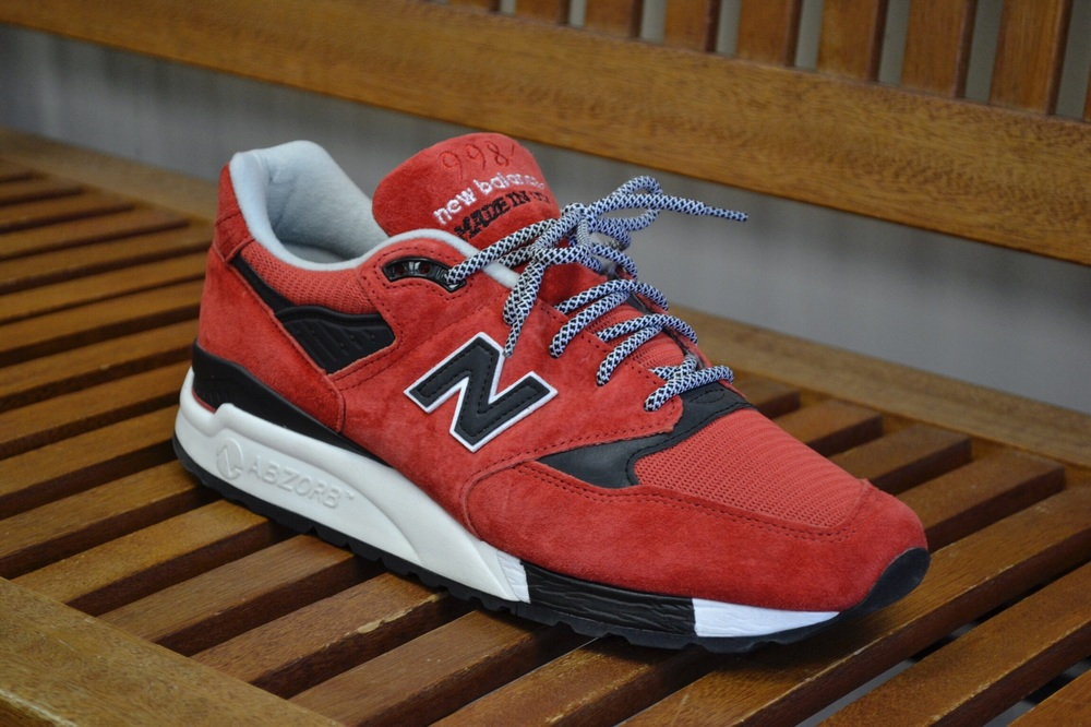 An up close look at the Made in the USA New Balance 998 in a Red, Black, and White colorway.