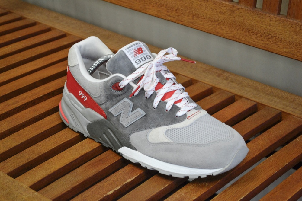 An up close look at the New Balance 999 Elite in a Grey, Red, and White colorway.
