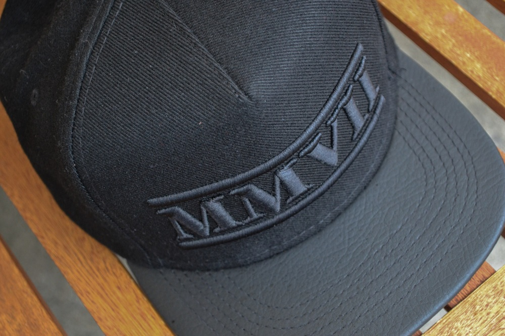 The DBSMC MMVII Snapback returns, this time featuring an all wool crown, and Black vinyl brim.