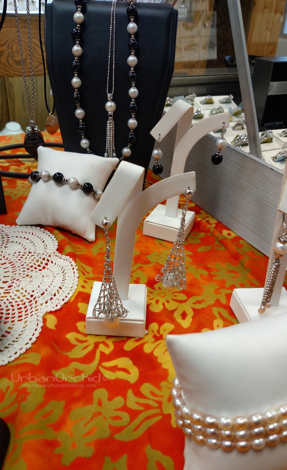 Pearl jewelry on the sales table.  Love the beaded structure on those earrings.