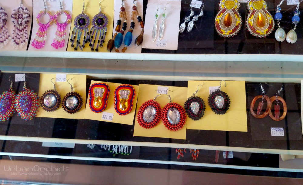 I may be easily distracted by sparkly things.  Love those red and black earrings with the opalescent stone in the middle.  Also, there are buttons that rotate the racks in the jewelry cases so you can see everything without having to crouch over.
