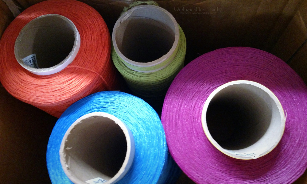 Yarn made of recycled plastic, which eventually gets made into wall covering.