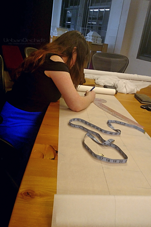 Cobilee making modifications to the metal pattern.