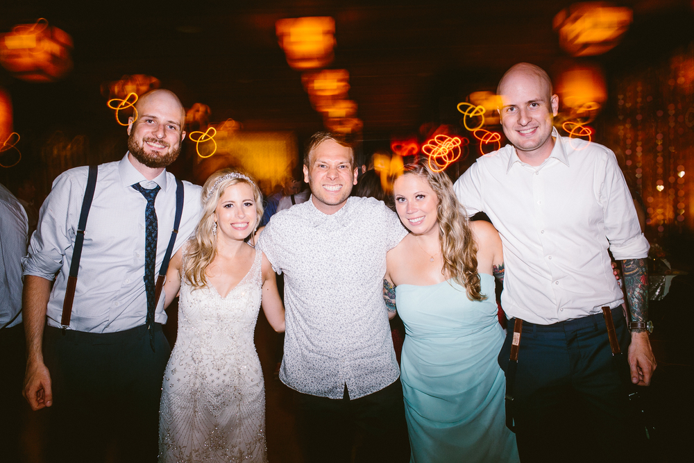 Courtesy of  Redfield Photography 2 Happy couples! Twinning.Wedding @  The Park NYC