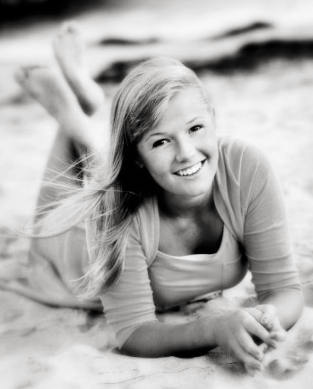Back when I was a senior in high school, senior pictures were a big deal! I remember loving my picture the most because I was lucky enough to get to have them in the beach (being from Missouri I was a little different then everyone else's) and was very excited to show my friends how well they turned out. I loved this picture in particular because of the how the wind was blowing my hair in a good (but not too wild) way. Haha I sound dumb right? Anyways it was an impressive shot that you had to take on the ground considering you were very pregnant at the time! Haha! Thanks for the great pictures all those years ago!