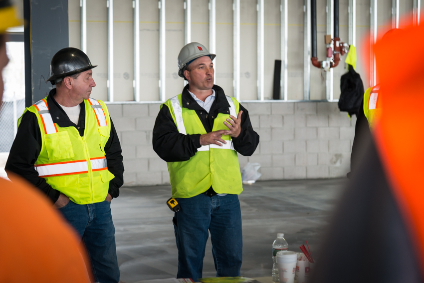 March Safety-OSHA: March Superintendent Dave Van Lenten (right) discusses daily procedures and March General Superintendent Harry Richardson looks on.