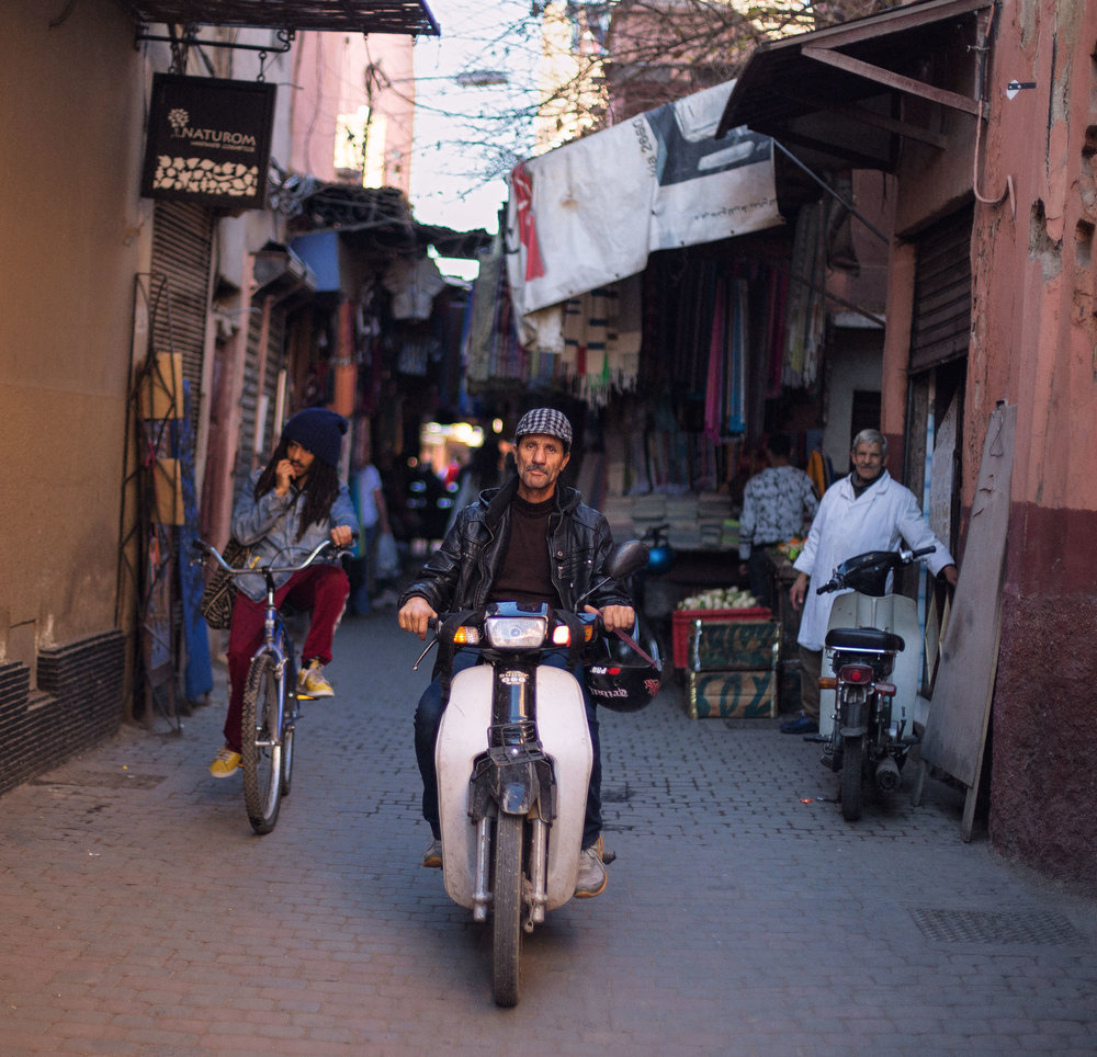 Mopeds and bikes are almost as common as pedestrians in Marrakech's labyrinthine and narrow side streets.