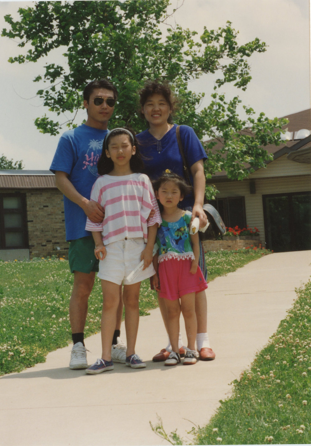 "Elise Byun and Family. ""I'm not sure of the exact year. My guess is 1991 or 1992. I think I'm 4 years old but my mom says 3 or 4. Don't I look too big to be 3 years old? Shrug."""