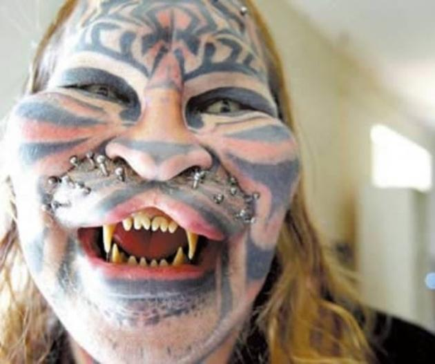 "Stalking Cat, born Dennis Anver, had extensive body modifications. He sadly committed suicide in 2012. Could he have been an otherkin? He ""strongly identified"" with a cat. Photo taken by WWGB. Image via Wikipedia"