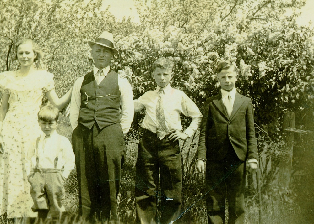 Some of the Tuchowski Family: From Left to Right Angie(Sister), Walter, Gregory (Father), John(Brother), and Frank(Brother) on the Tuchowski Farm, mid 1930s.