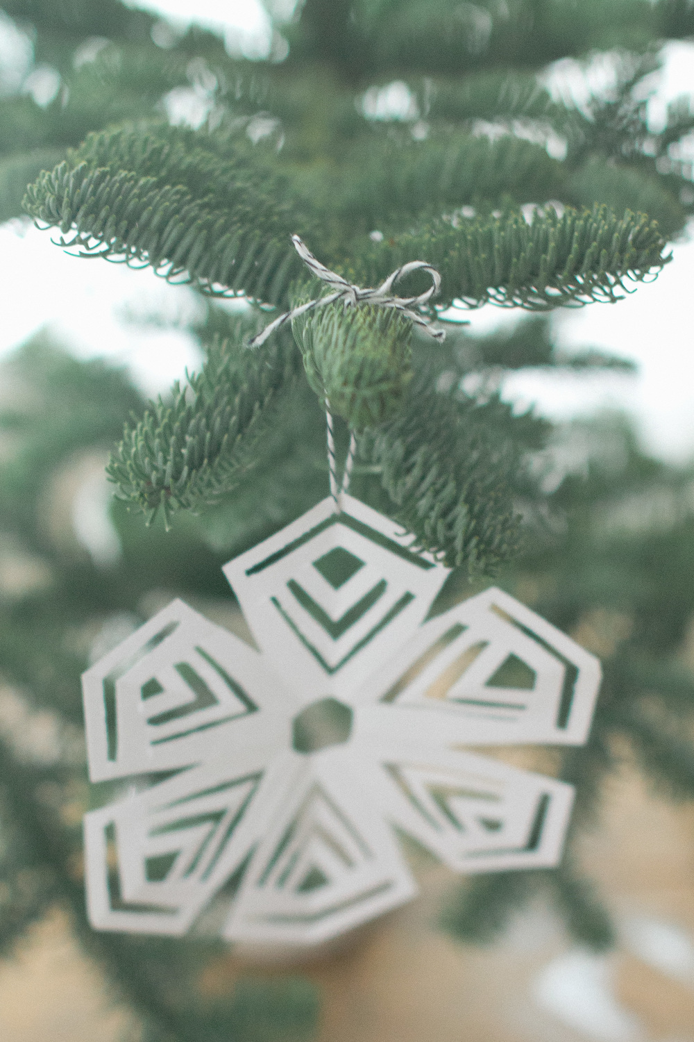 Tie on ornaments with bow in order to reuse the twine later | Keeper & Co. Blog