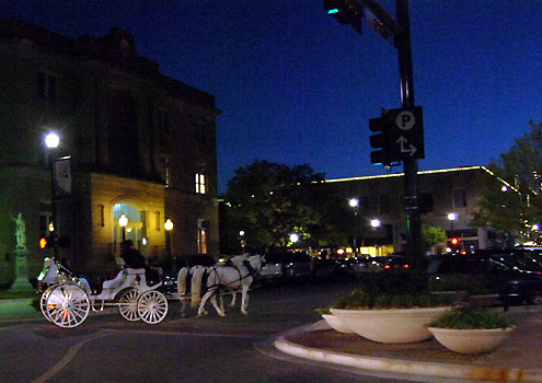 Enjoy an evening carriage ride around the square.
