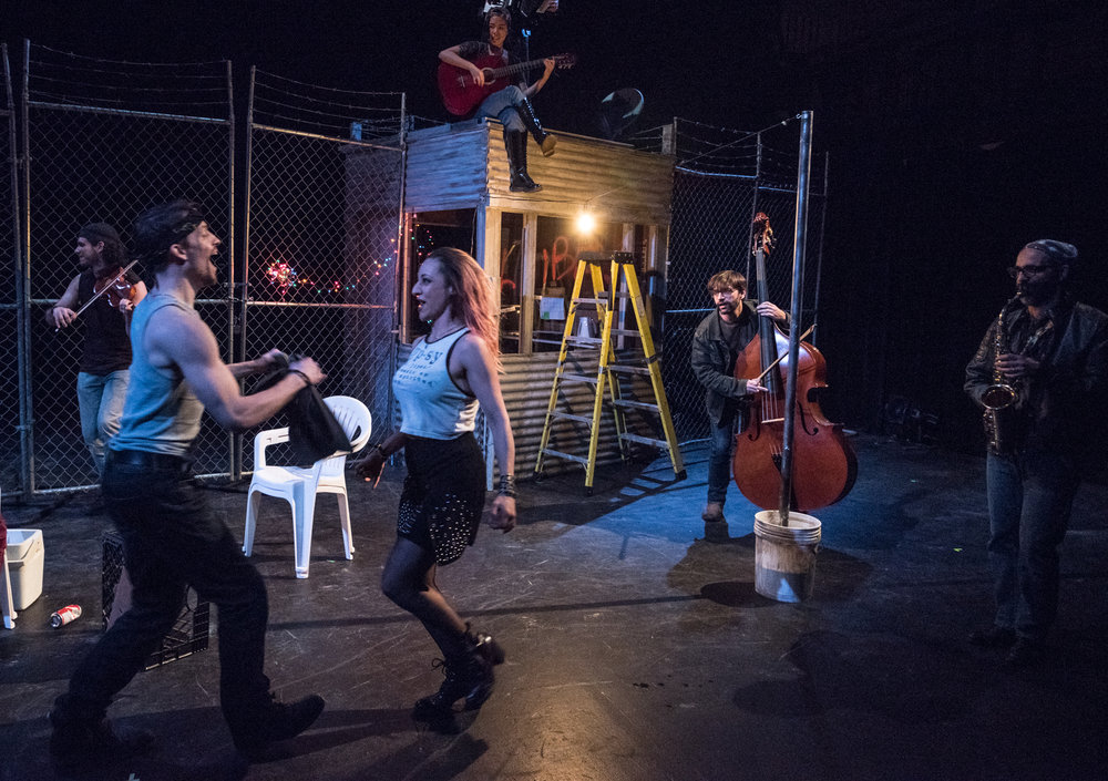 ENTR'ACTE - from Bizet's CarmenBaruch Performing Arts Center, May 2017Adapted & Directed by Louisa ProskeIn a new arrangement by Daniel Schlosberg for alto/baritone saxophone, violin/viola/electric violin, guitar/electric guitar, piano/accordion, and percussion.