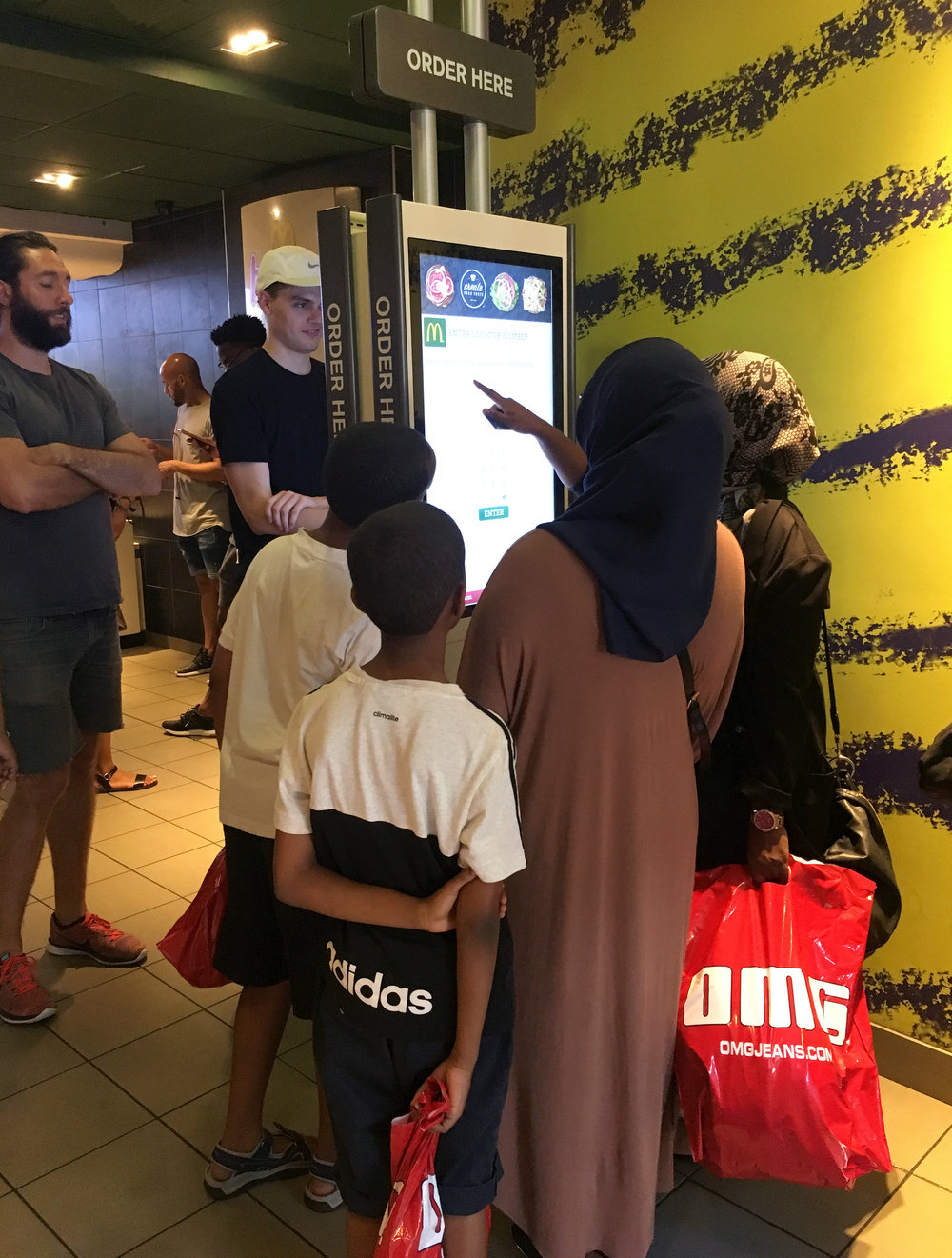 We conducted guerilla ethnographic research. On this day at the local McDonald's on Canal Street, I observed a family ordering as a group on the current Kiosk 5.X build.