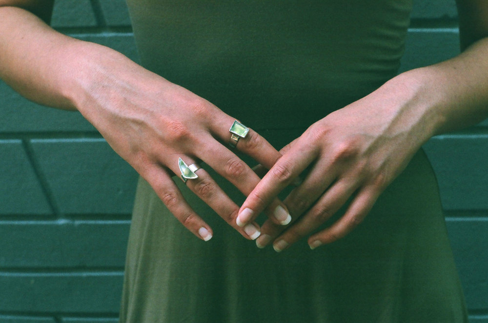 Original Purposerosa rings made with repurposed mirror shards.