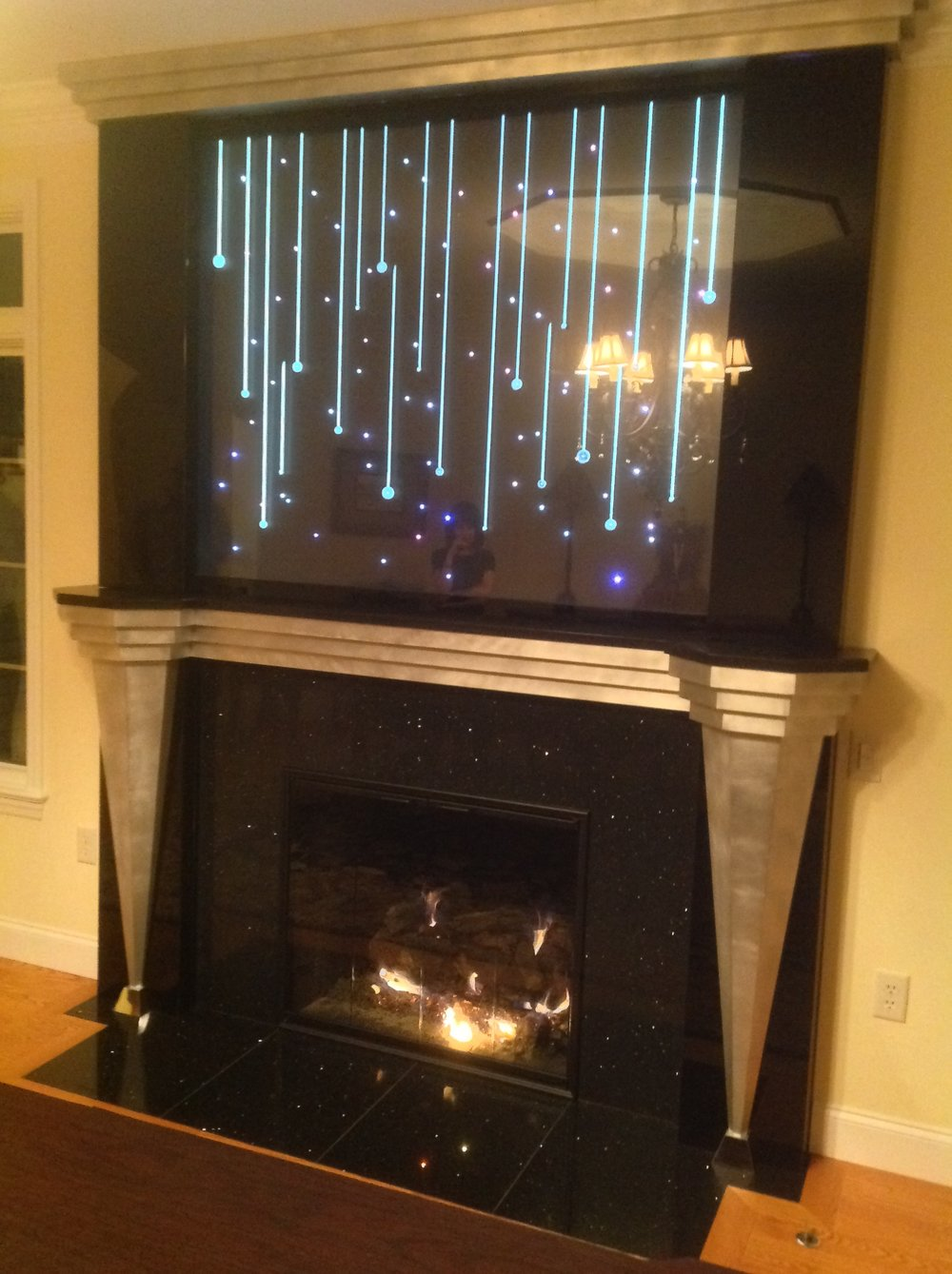 custom fireplace with cascading RGB lighting