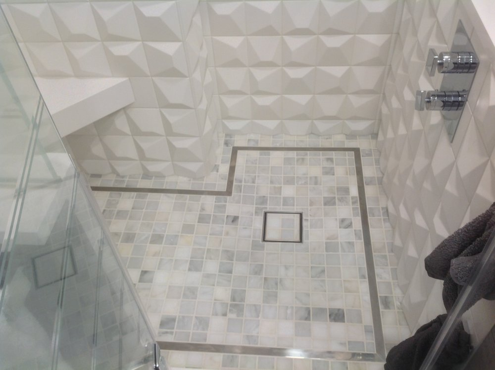 shower floor with inlaid stainless steel