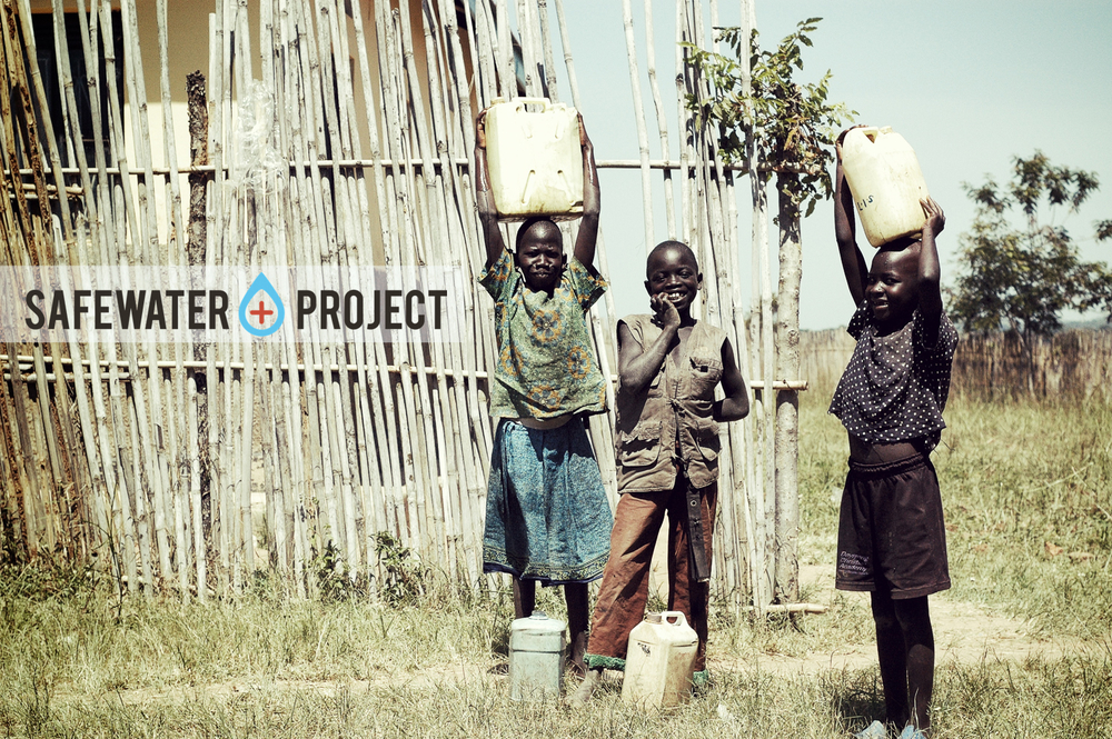 Safe Water project with boys.jpg