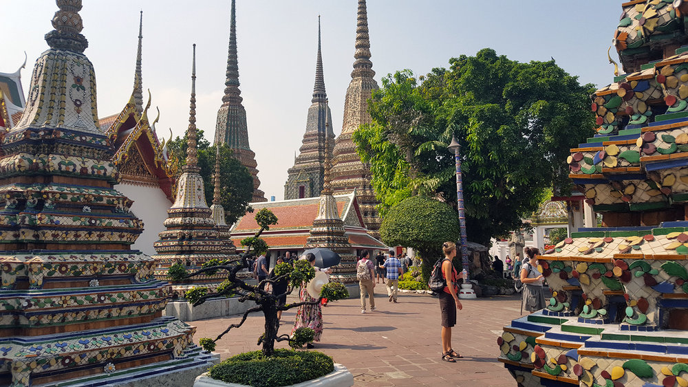 Wat Pho was our first temple experience in Thailand, and it was like walking into a secret temple garden.  Only one wall divides the noisy streets and this peaceful sanctuary, that is lined with various pathways all leading to something all equally impressive as the last.