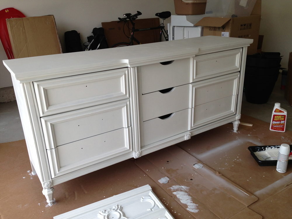 "I used a color called ""Oyster"" by Sherwin Williams, and applied 2 coats to the dresser"