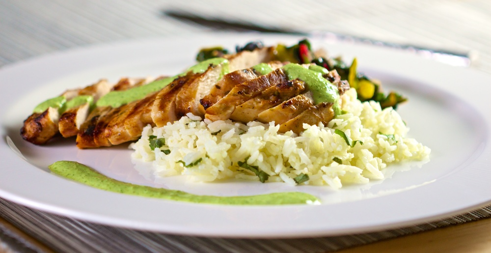 Grilled chicken over cilantro lime rice with roasted jalapeno sauce