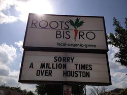 roots bistro apology sign