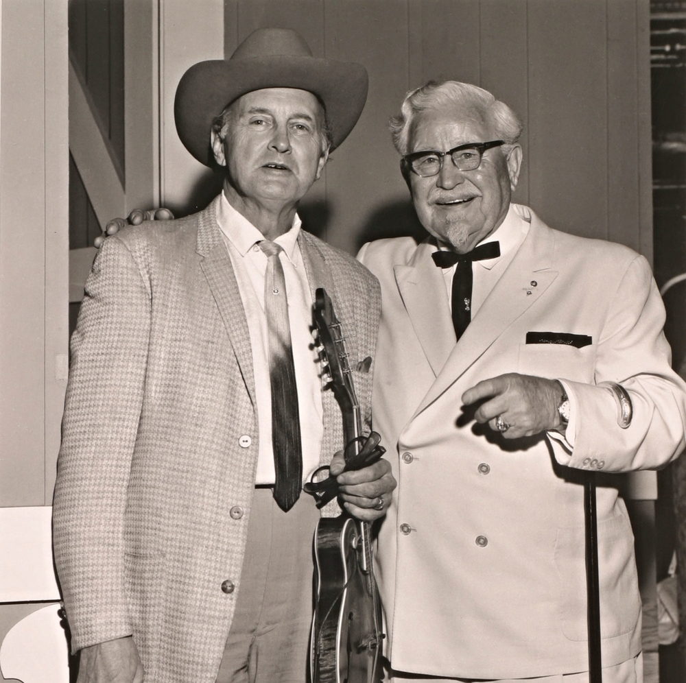 From the Archives:  Bill Monroe with Colonel Sanders.   Photo by Les Leverett.