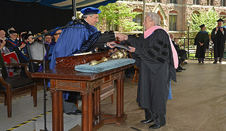 Ralph Stanley is awarded his honory degree by President Peter Salovey, a longtime member of the Professors of Bluegrass and former Chairman of the IBMM Board of Trustees.  Photo by Michael Marsland.