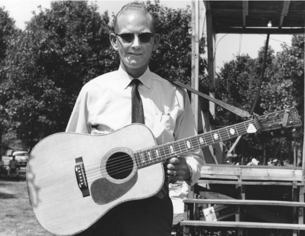 From the Archives:  Red Smiley with his D45 Martin Guitar at the Roanoke Blue Grass Festival in Fincastle, Virginia 1965.   Photo by Ron Petronko.