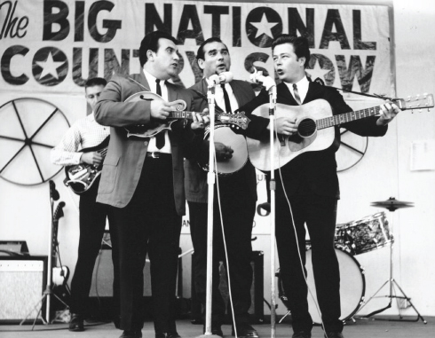 From the Archives:  Bobby Osborne- mandolin, Sonny Osborne- banjo, Gordon Cash-guitar (Bass player unidentified) at the Big National Country Show at Ponderosa Park in Ohio on August, 29th 1965.  Photo by Ron Petronko.