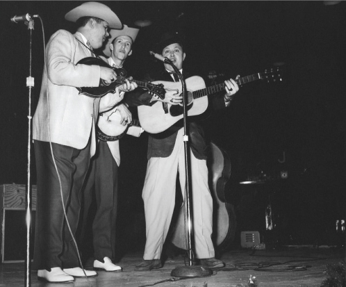 From the Archives:  Paul Williams, J.D. Crowe, and Jimmy Martin and Zeb Collins in 1958 at the WWVA Package Show in Ottawa Auditorium at Lansdowne Park in Ottawa Ontario, Canada.. Photo by Ron Petronko.