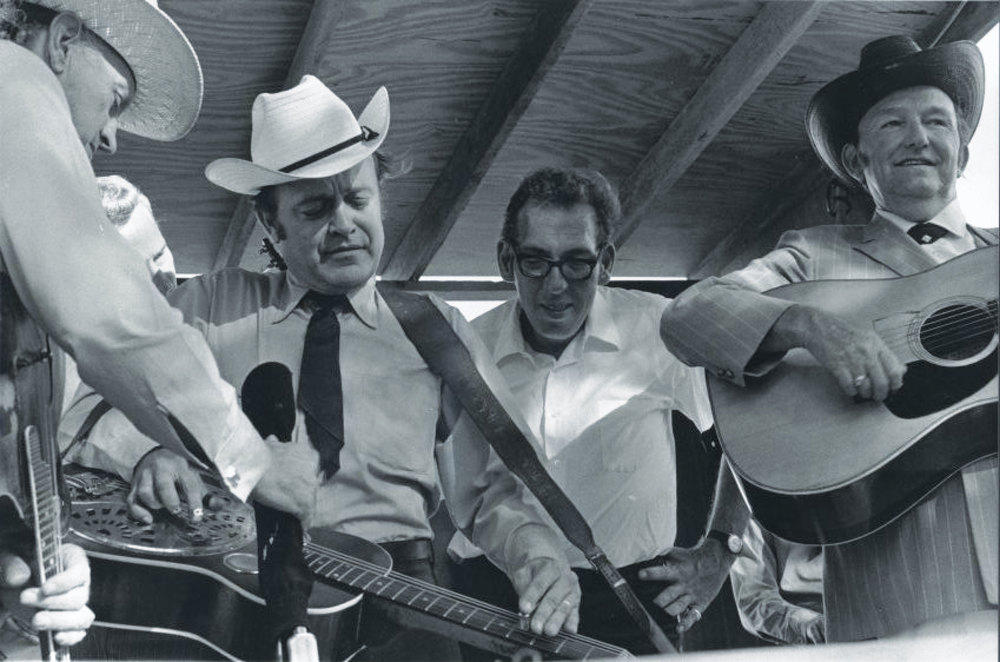 From the Archives:  Bill Monroe, Josh Graves, Bill Harrell, and Lester Flatt believed to be in Garland, Texas 1971.   Photo by Ron Petronko.