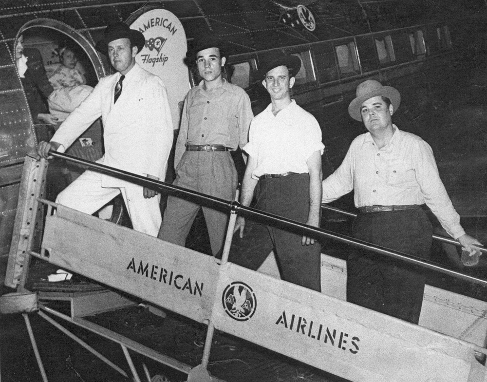 "From the Archives:  Bill Monroe and the Blue Grass Boys boarding a plane to travel to Washington , D.C. July, 1946. L-R: Bill Monroe; Earl Scruggs; Howard ""Cedric Rainwater"" Watts; Chubby Wise. Lester Flatt had already entered the plane.   Donated by Jarrett and Gail Watts."
